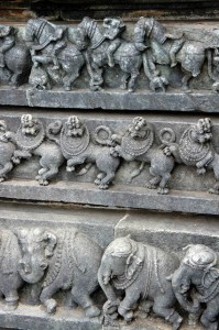 The intricate workmanship includes elephants, lions, horses, episodes from the Indian mythological epics, and sensuous dancers (Shilabalikas).